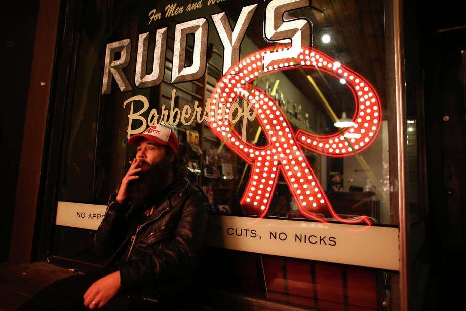 "Neil McAdams checks out the bright red ""R"" outside King's Hardware in Ballard. Photo: JOSHUA TRUJILLO, SEATTLEPI.COM / SEATTLEPI.COM"
