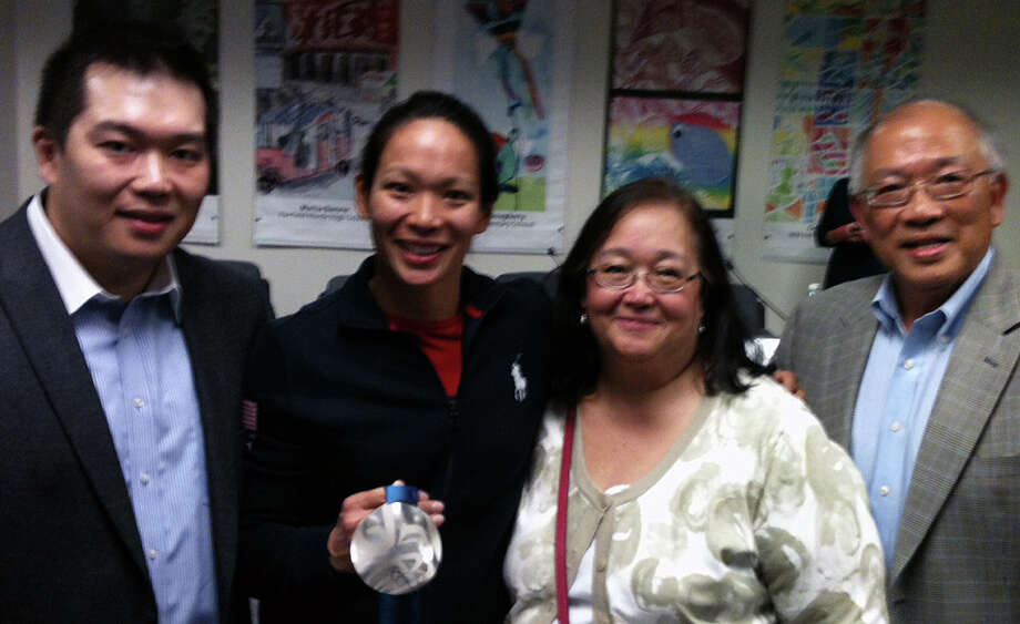 Olympic silver medalist Julie Chu came to Tuesday night's Board of Education meeting with her brother Richard, mother Miriam and father Wah Chu. Photo: Andrew Brophy / Fairfield Citizen contributed