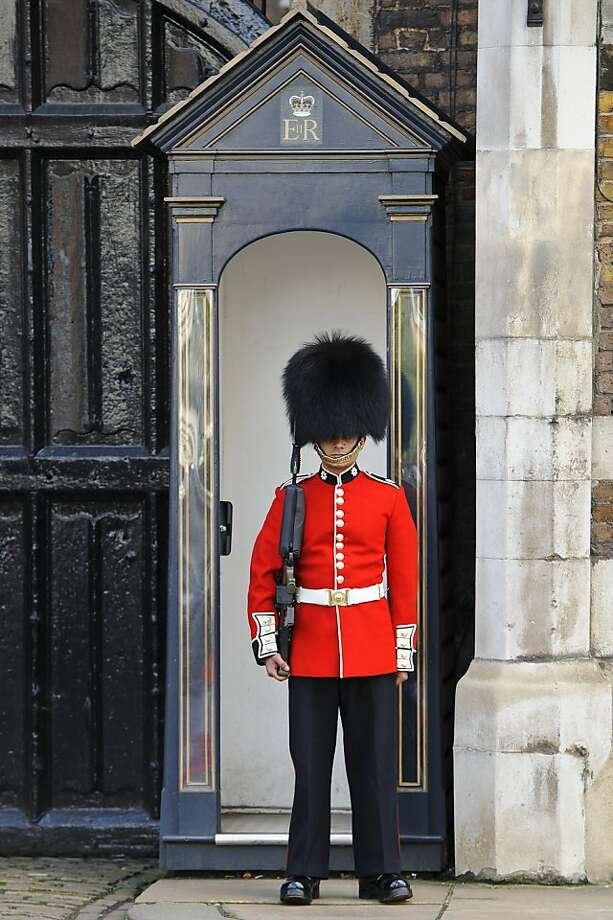 A Queen's Guard keeps watch over the entrance of the palace ahead of the christening of HRH Prince George Of Cambridge at St James's Palace on October 23, 2013 in London, England. Photo: Ben A. Pruchnie, Getty Images