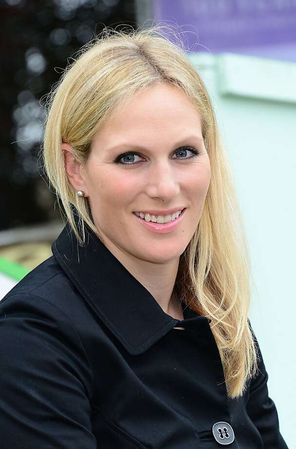 FILE - In this Monday, May 20, 2013 file photo, Zara Phillips is seen at the RHS Chelsea Flower Show in London. Prince William and his wife Kate have asked seven people including Zara Phillips,  to be godparents to their son, Prince George, who will be christened at a major royal family gathering Wednesday, Oct. 23, 2013,  palace officials said. Queen Elizabeth II and her husband Prince Philip plan to attend the christening Wednesday at the Chapel Royal at St. James's Palace, along with Prince Charles, his wife Camilla, Prince Harry and other royals. Photo: Jon Furniss, Associated Press