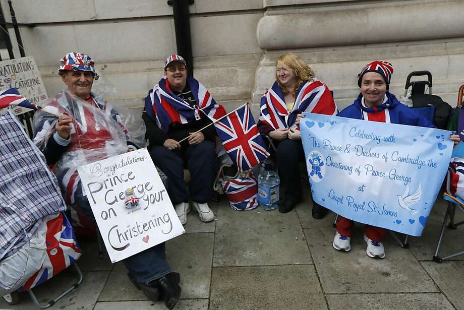 British Royal Family fans  from left, Terry Hutt, Julie Cain, Marie Scott and John Loughrey camp up outside the Chapel Royal, St James's Palace in London ahead of the christening of Prince George, Tuesday, Oct. 22, 2013. The royal christening ceremony of Prince George, son of Prince William and Kate, Duchess of Cambridge is to take place at the Chapel Royal in St James's Palace on Wednesday. Photo: Sang Tan, Associated Press