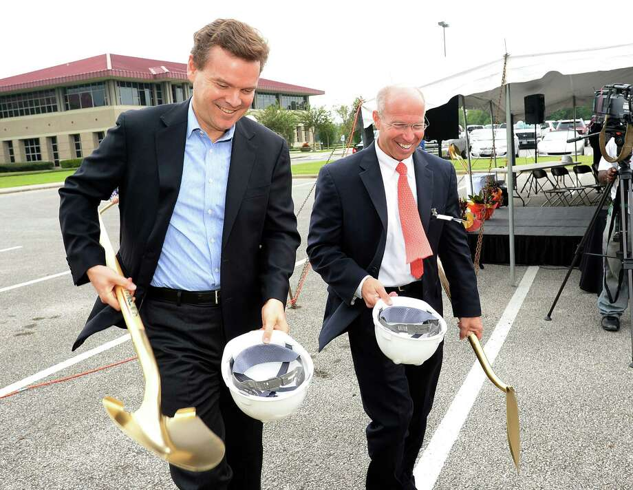 Peter Huntsman, CEO of Hunstman Corp., and Stu Monteith during Tuesday's groundbreaking ceremony for a new natural gas production unit at the Huntsman Port Neches plant. The ceremony kick starts a $150 million expansion program in a neighboring area. Photo taken Tuesday, October 22, 2013 Guiseppe Barranco/The Enterprise Photo: Guiseppe Barranco, Photo Editor
