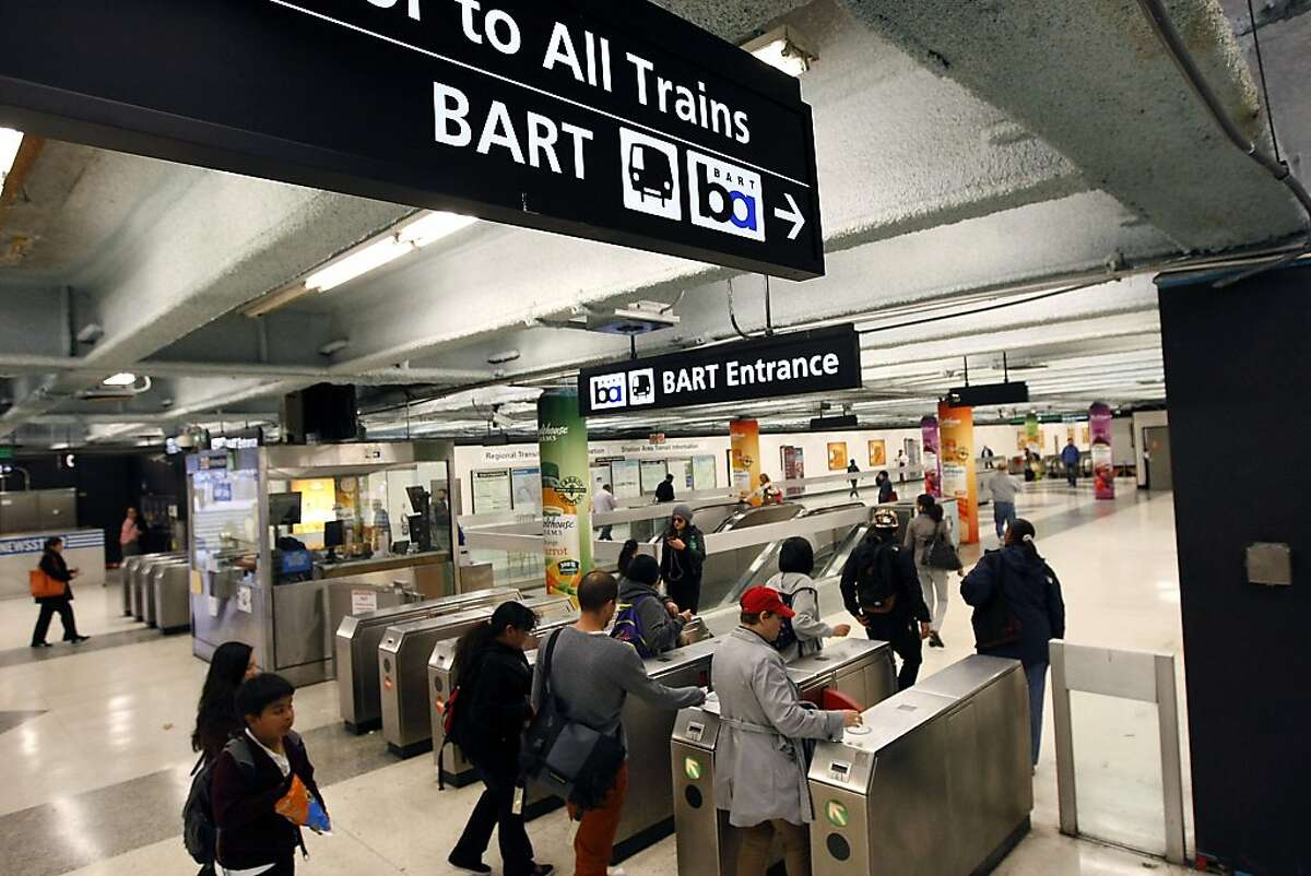 Commuters pass through the turnstiles at the Powell St. BART station in San Francisco, CA Tuesday, October 22, 2013. BART service was restored system wide after management and union workers reached an agreement on a new contract.