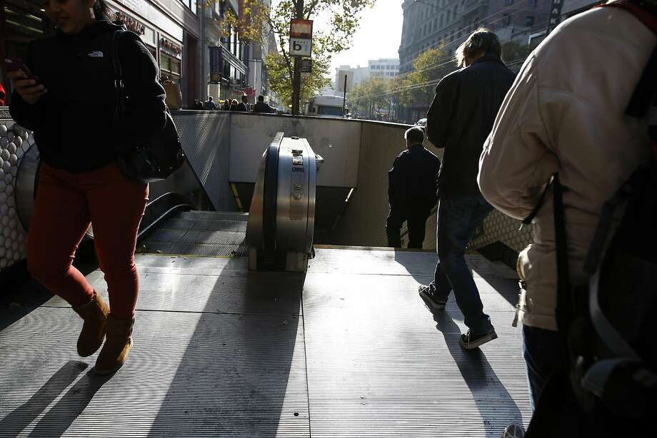 The escalators at two Powell Street BART Station portals and one at Civic Center will be replaced and canopies installed. Photo: Michael Short, The Chronicle