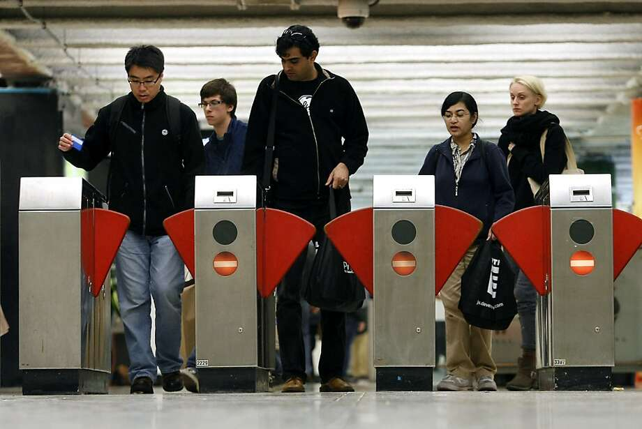 Commuters pass through the turnstiles at the Powell St. BART station in San Francisco, CA Tuesday, October 22, 2013. BART service was restored system wide after management and union workers reached an agreement on a new contract. Photo: Michael Short, The Chronicle