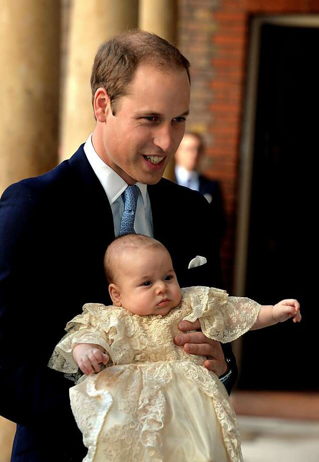 Prince William, Duke of Cambridge arrives, holding his son Prince George, at Chapel Royal in St James's Palace, ahead of the christening of the three month-old Prince George of Cambridge by the Archbishop of Canterbury on October 23, 2013 in London, England. Photo: WPA Pool, Getty Images