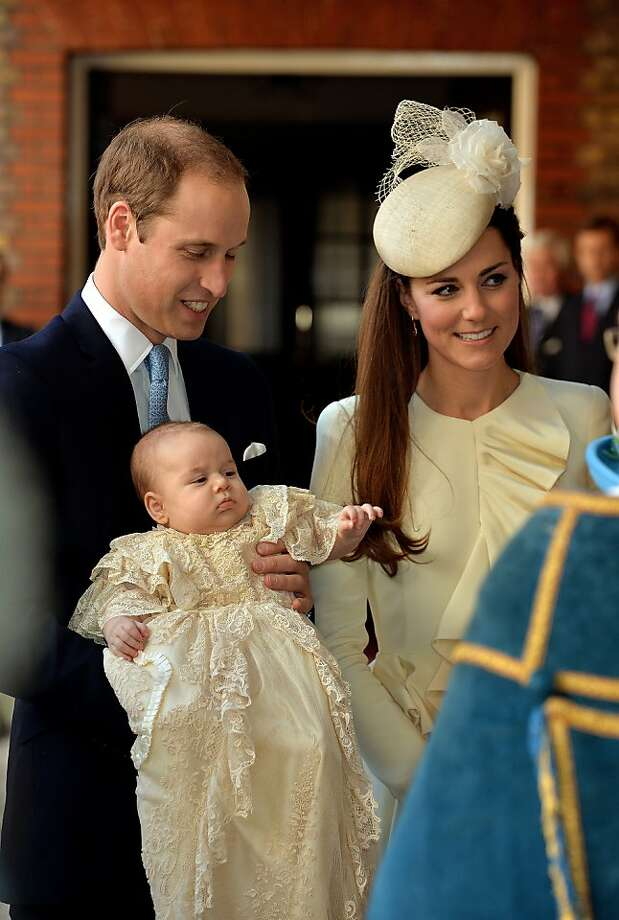 Prince William, Duke of Cambridge and Catherine, Duchess of Cambridge arrive, holding their son Prince George, at Chapel Royal in St James's Palace, ahead of the christening of the three month-old Prince George of Cambridge by the Archbishop of Canterbury on October 23, 2013 in London, England. Photo: WPA Pool, Getty Images
