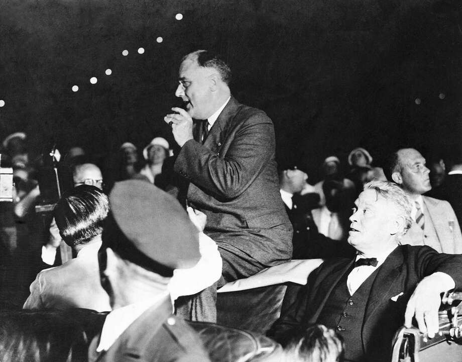 Feb. 16, 1933: President-elect Franklin D. Roosevelt speaks in Miami, Florida, just before an attempt on his life by Giuseppe Zangara. Photo: Associated Press / AP1933