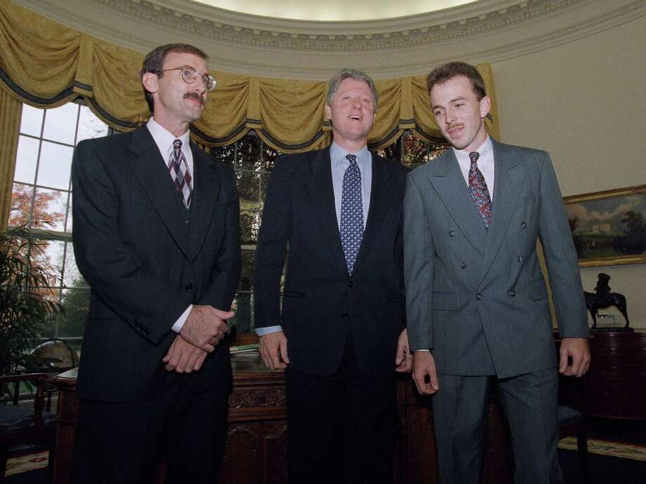 President Bill Clinton shown with Harry Rakosky of San Antonio, Texas, left, and Ken Davis of Hagerstown, Maryland, in the Oval Office of the White House in Washington on Nov. 8, 1994. The president met with both men who helped subdue alleged White House gunman Francisco Martin Duran. Photo: Wilfredo Lee, Associated Press / AP