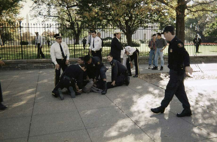 October 29, 1994: Francisco Martin Duran fired at least 29 shots with a semi-automatic rifle at the White House from a fence overlooking the north lawn, thinking that President Bill Clinton was among the men in dark suits standing there (Clinton was inside.) Three tourists, Harry Rakosky, Ken Davis and Robert Haines, tackled Duran before he could injure anyone. Found with a suicide note in his pocket, Duran was sentenced to 40 years in prisonSource: Wikipedia Photo: Felix Castillo,Jr., Associated Press / AP1994