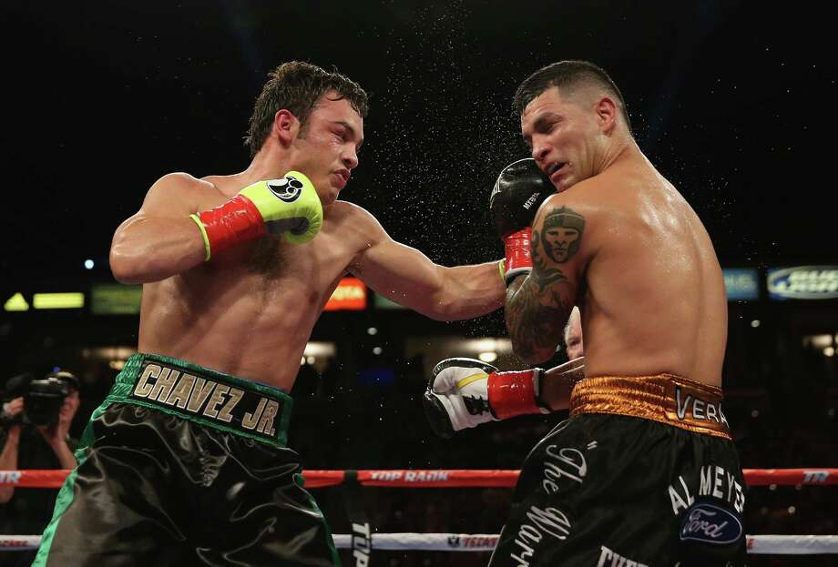 LOS ANGELES, CA - SEPTEMBER 28:  Julio Cesar Chavez Jr. (L) lands a left hand to the head of Bryan Vera during their Light Heavyweight bout at StubHub Center on September 28, 2013 in Los Angeles, California.  (Photo by Jeff Gross/Getty Images) Photo: Getty Images / 2013 Getty Images