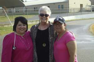 Aracely Novack, school nurse (left), and Shepard Middle School's Fun Run organizer Melissa Campos (right) with Sharon Knox (center) at a fundraiser prior to Knox's death last year.