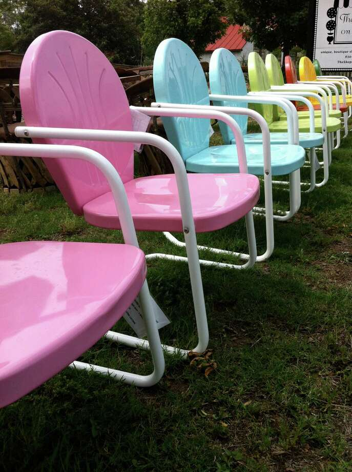 """FredericksburgAmong other things, Fredericksburg is being recognized as a """"mini Napa"""" because of its wine culture. Wine aficionados are finding their way to this eclectic little town. There are also some great places to shop and hike. There is something for everyone.Retro chairs in bright colors line the lawn of the Shops on Llano.Read: Experiencing Fredericksburg Photo: Terry Scott Bertling"""