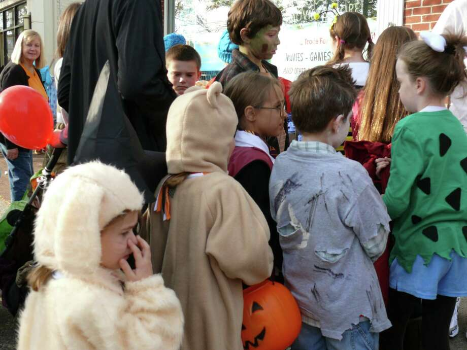 "Costumed children won't crowd the sidewalks this year with the cancellation of the popular ""Trick or Treat on Safety Street."" Photo: Genevieve Reilly / Fairfield Citizen"