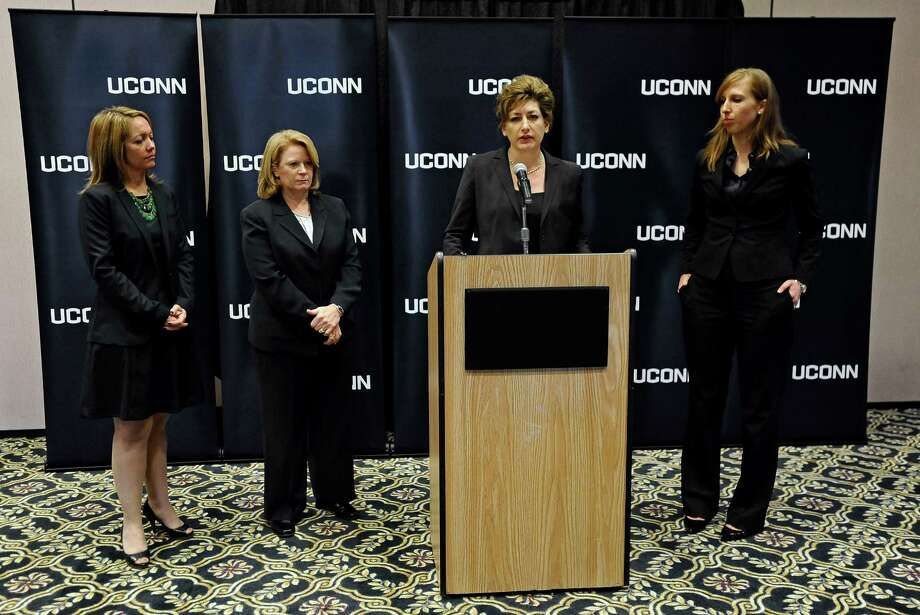 University of Connecticut President Susan Herbst, at podium, speaks to the media about the federal civil rights complaint filed Monday by seven women, as Associate General Counsel to the UConn Nicole Gelston, left, UConn Police Chief Barbara O'Connor, second from left, and UConn Title IX Coordinator Elizabeth Conklin, right, look on, Wednesday, Oct. 23, 2013, in Storrs, Conn. The seven women allege they were assaulted while attending UConn and that officials responded with deliberate indifference or worse. Photo: Jessica Hill, AP/Jessica Hill / Associated Press Connecticut post contributed