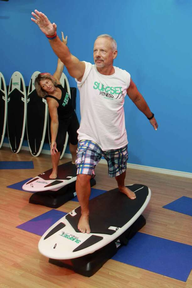 Chris and Rina McNeill demonstrate a surfing workout at their fitness studio, SurfSet Fitness Houston. Photo: Gary Fountain, Freelance / Copyright 2013 Gary Fountain.