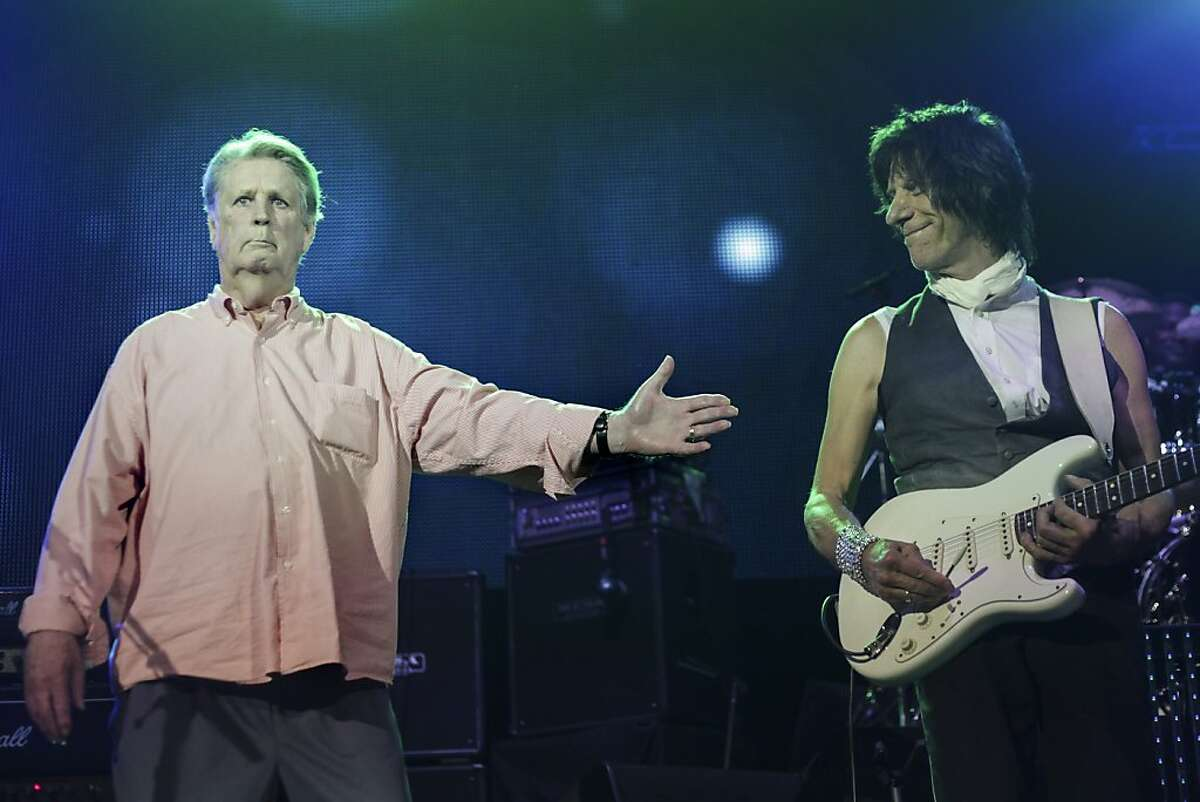 The Beach Boys' chief songwriter Brian Wilson (left) gestures to famous guitar player Jeff Beck at the end of a concert held at the Paramount Theater with Brian Wilson, Jeff Beck and three other original Beach Boys band members in Oakland on October 22nd 2013.
