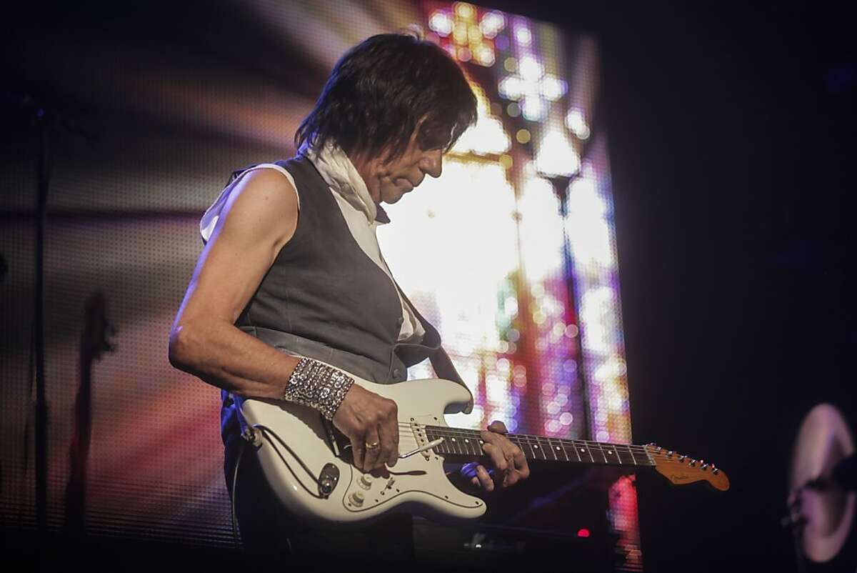 Famous guitar player Jeff Beck plays guitar during a concert held at the Paramount Theater with the Beach Boys' chief songwriter Brian Wilson, and three other original Beach Boys band members on October 22nd 2013.