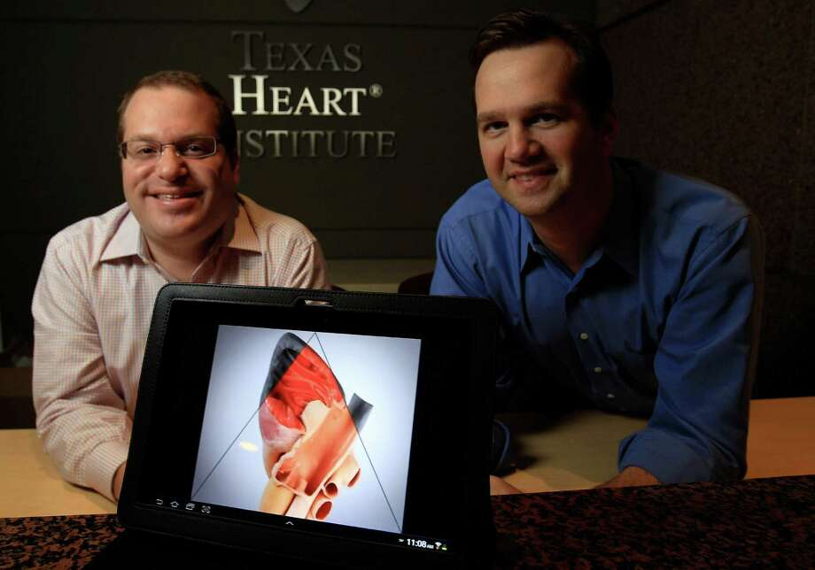 Aaron Cohan, left, and Mark Johnson of Amerra produce videos that show how to perform surgeries and other medical procedures. They also are working on a heart atlas with the Texas Heart Institute at St. Luke's Health System. Photo: Karen Warren, Staff / © 2013 Houston Chronicle
