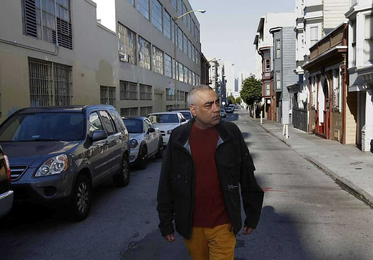 Aman Jabbi walks along Minna St. between 8th and 9th streets, in San Francisco, Calif. on Tuesday Oct. 22, 2012. The streets around Aman Jabbi's home on Minna Street is strewn with trash, feces and awash in urine. Jabbi recently started a tumblr FilthySF that records every aspect of the dirty street to pressure local officials into cleaning up the area.