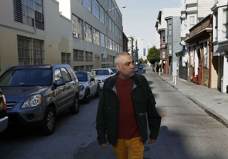 Above; Aman Jabbi walks along Minna Street between Eighth and Ninth streets - not far from his home. Photo: Michael Macor, The Chronicle