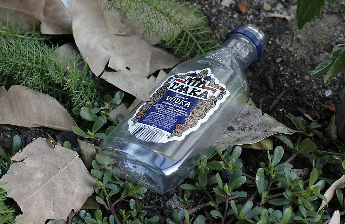 An empty liquor bottle discarded along Minna St. between 8th and 9th streets, in San Francisco, Calif. on Tuesday Oct. 22, 2012. The streets around Aman Jabbi's home on Minna Street is strewn with trash, feces and awash in urine. Jabbi recently started a tumblr FilthySF that records every aspect of the dirty street to pressure local officials into cleaning up the area.