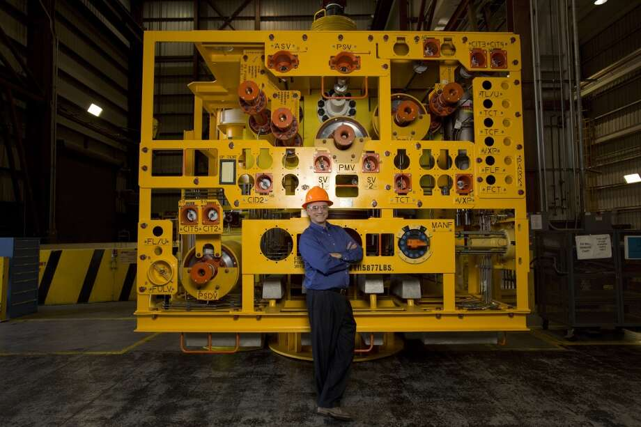Tim Thornton, global technical assurance manager of global subsea engineering for FMC Technologies, stands next to a subsea Christmas tree built for Shell Oil. Photo: Eric Kayne, For The Houston Chronicle