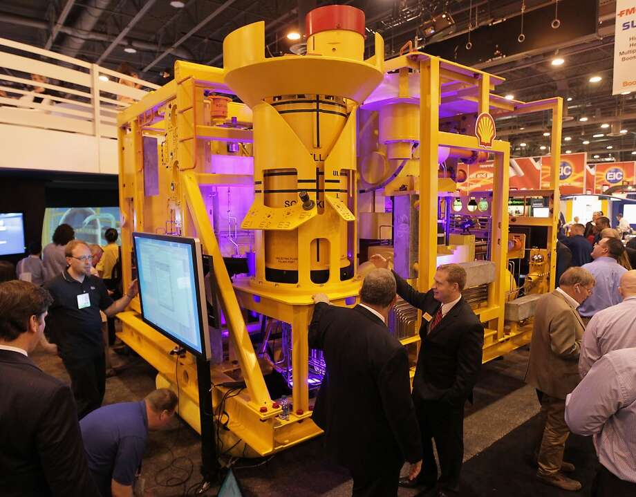 A 15K enhanced vertical deep-water tree, or EVDT, is displayed at the FMC Technologies booth at the 2013 Offshore Technology Conference in Houston. Photo: James Nielsen, Houston Chronicle