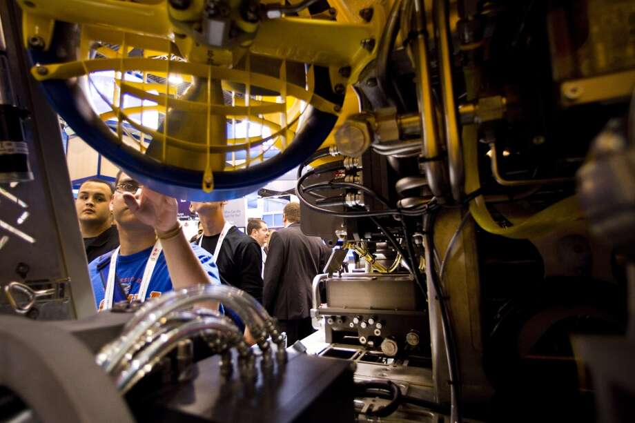 Pasadena High School student Edgar Lizcano looks at an Remotely Operated Vehicle at the FMC Technologies booth during the 2012 Offshore Technology Conference in Houston.= Photo: Brett Coomer, Houston Chronicle