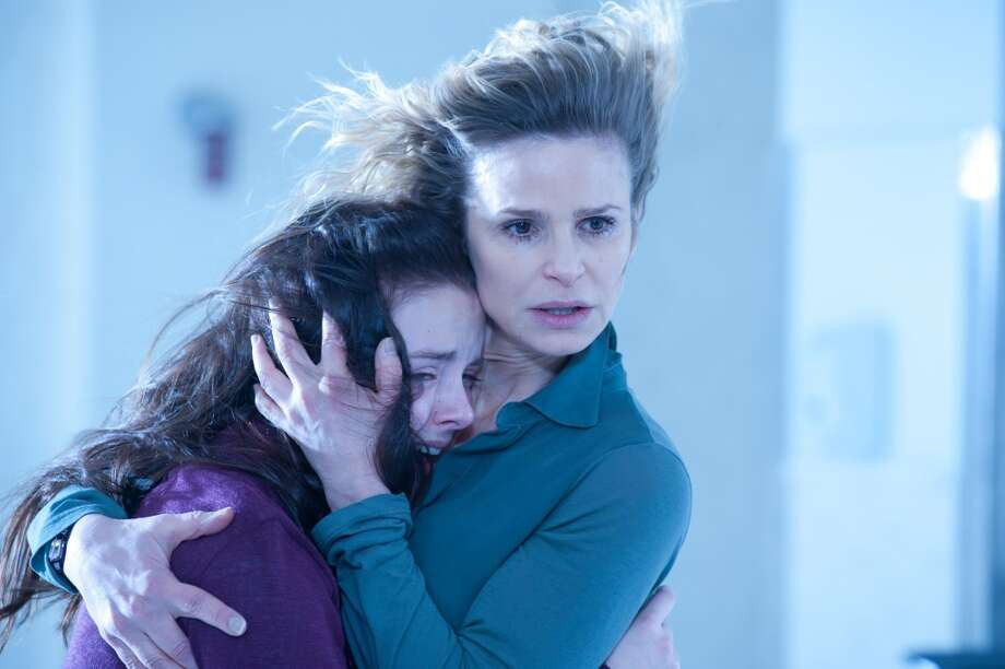 "Madison Davenport, left, and Kyra Sedgwick in a scene from ""The Possession."" (AP Photo/Lionsgate, Diyah Pera) Photo: Diyah Pera, AP"