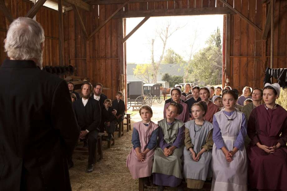 Madison Davenport of San Antonio (second from far right) in a Sunday church service scene from 'Amish Grace.' Photo:Jack Zeman/Lifetime Movie Network. Photo: JACK ZEMAN, LIFETIME MOVIE NETWORK