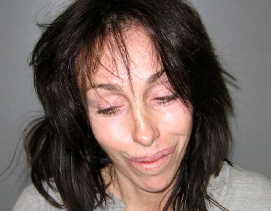 Former Hollywood madam Heidi Fleiss is shown in a booking photo after she was arrested on charges of illegal possession of prescription drugs and driving under the influence. Authorities say Fleiss was arrested again on Oct. 22, 2013, in Nevada after deputies found her driving under the influence of marijuana.