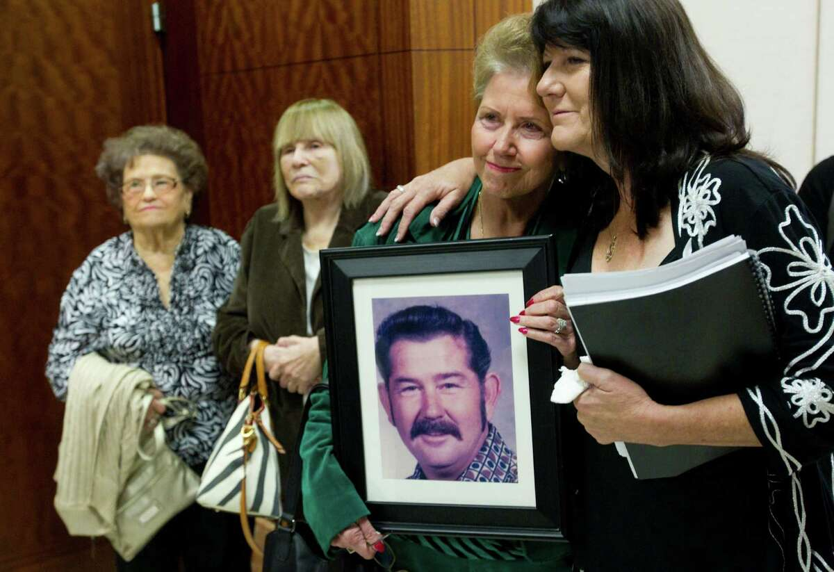 Linda Petty, sister of murder victim Roy Joe McCaleb, and Pamela Nalley, McCaleb's daughter, right, embrace following the court appearance by Carolyn Krizan-Wilson Wednesday, Oct. 23, 2013, in Houston. Krizan-Wilson pled guilty in the 1985 shooting death of her husband, Roy Joe McCaleb. The murder was a cold case for years. She was arrested in 2008. She was sentenced to 10 years probation and six months in jail