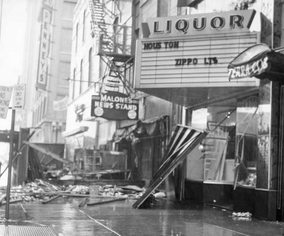 In 1961, Hurricane Carla swept through Galveston and Houston. Pictured is some wreckage in Downtown Houston. Photo: Sam C. Pierson Jr., Houston Chronicle / Houston Chronicle