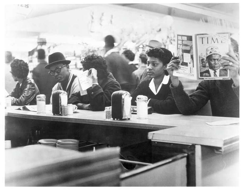 March 4, 1960 sit-in at Weingarten supermarket located at 4110 Almeda.  These were TSU students. Harold L. Stovall is gentleman with glasses and hat.  Halcyon Sadberry Watkins shown on right was a 20 year old TSU student when she sat at the counter. Pete Hogrobrooks is reading Time magazine at the far right.  staff / Houston Post   HOUCHRON CAPTION (02/04/1998):  In the early '60s, Houston students began a quiet fight against segregation through peaceful sit-ins, such as this one at a Weingarten's lunch counter. They feared a violent backlash like those in other Southern cities. To their surprise, it never came.  HOUCHRON CAPTION (12/22/2002):  In the early 1960s, students in Houston began a peaceful fight against segregation through sit-ins such as this one at a Weingarten's lunch counter.  OUTLOOK. Photo: © Houston Chronicle / Houston Post files