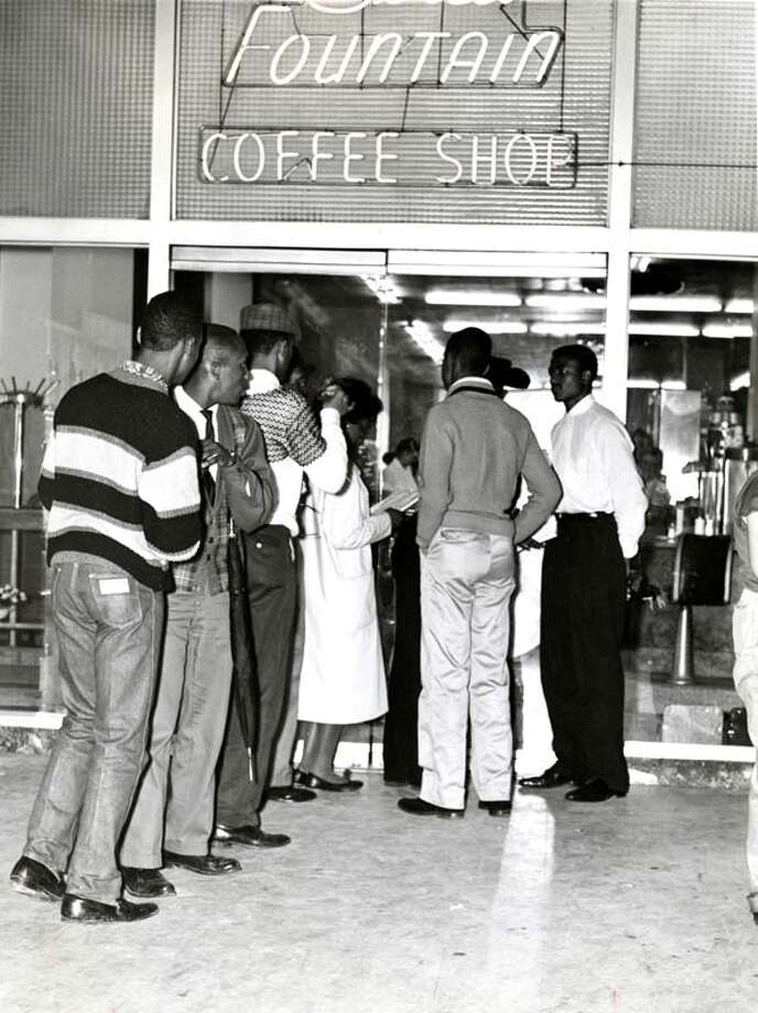 During the Civil Rights movement, demonstrators participated in sit-ins like the one pictured at the Union Station coffee shop in Houston in February 1961. Twelve Demonstrators were arrested. Photo: Dale Bodiker, © Houston Chronicle / Houston Chronicle