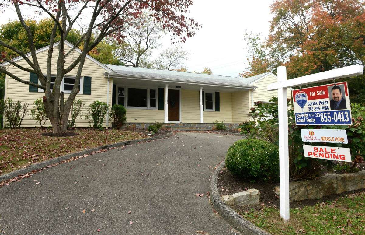 A house with a sale pending at 16 Acton Road in Bridgeport, Conn.