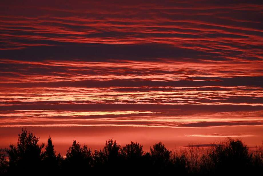 Red sky in the morning ...  The sunrise colors the sky over Calais, Vt. Rain and colder weather was 