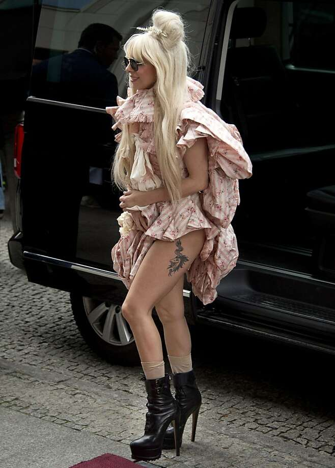 Halloween's next week, Ms. Gaga: Lady Gaga arrives at the Ritz Carlton in Berlin wearing stiletto boots and rolled-up bed sheets, 