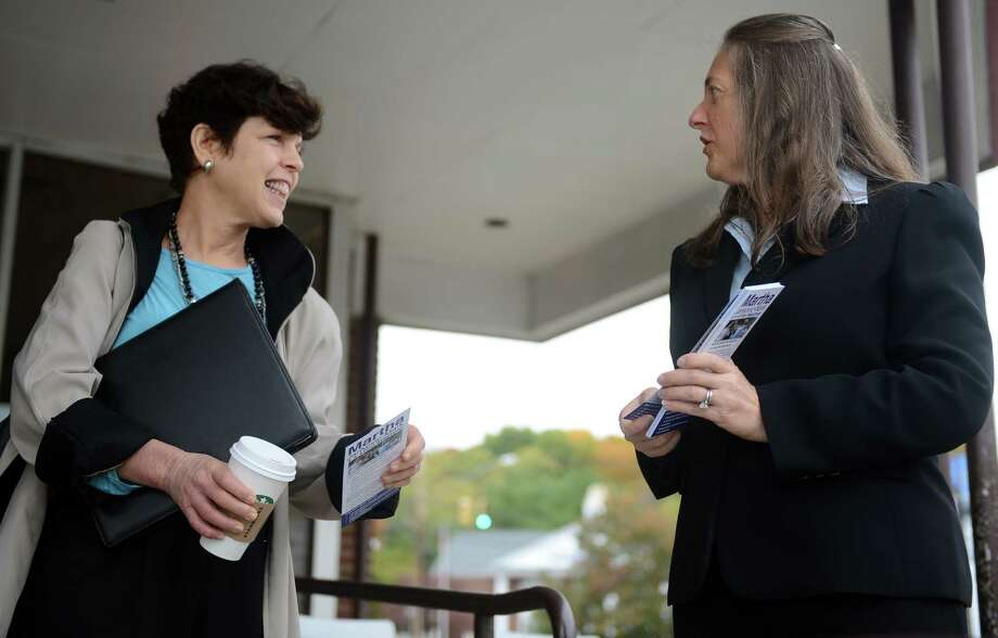 Democrat Martha Jankovic Mark talks with Helen Altman-Felsher while campaigning for First Selectman of Trumbull, running against Republican First Selectman Tim Herbst, Tuesday, Oct. 23, 2013. Photo: Autumn Driscoll / Connecticut Post