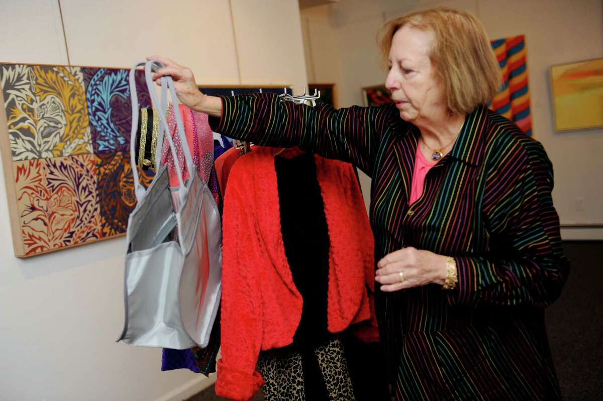 Christine Irvin, shows a light bag and jacket for women who were recovering from breast cancer at Stamford Art Association, in Stamford Conn., Wednesday, Oct. 23, 2013. Irvin and Laura Kamen created Alloro, a 15-piece collections of tops and dresses.