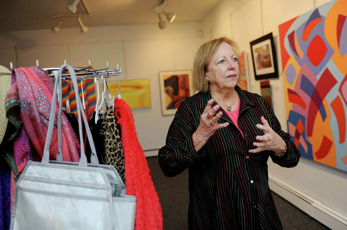 Christine Irvin, shows a light bag for women who were recovering from breast cancer at Stamford Art Association, in Stamford Conn., Wednesday, Oct. 23, 2013. Irvin and Laura Kamen created Alloro, a 15-piece collections of tops and dresses.