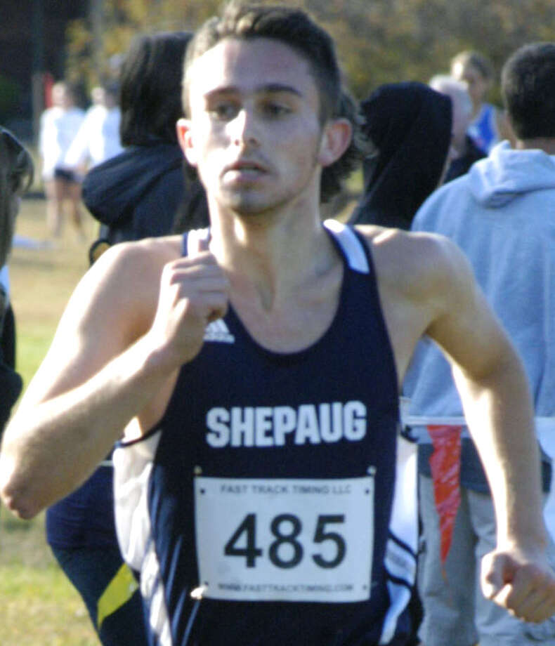 Clayton Firmender proves the best of the Shepaug Valley High School boys' cross country pack as he runs the homestretch of the Berkshire League boys' championship race at Black Rock State Park in Thomaston. Oct. 18,2013 Photo: Norm Cummings / The News-Times