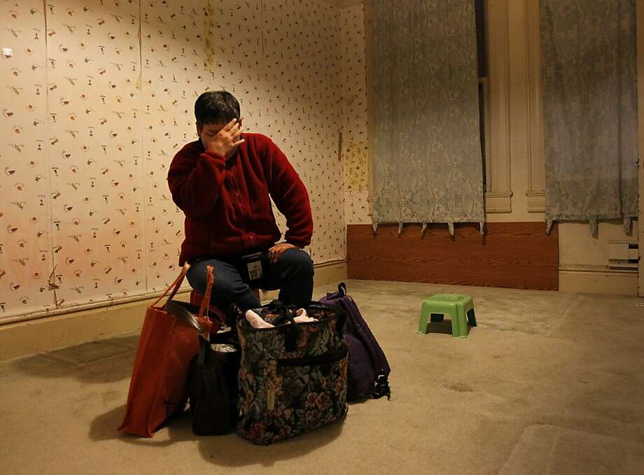 Shiu Man Lee, who is mentally challenged, waits in her bedroom for her mother on the night they must leave their home forever Tuesday, October 22, 2013, in San Francisco.  Photo: Brant Ward, The Chronicle