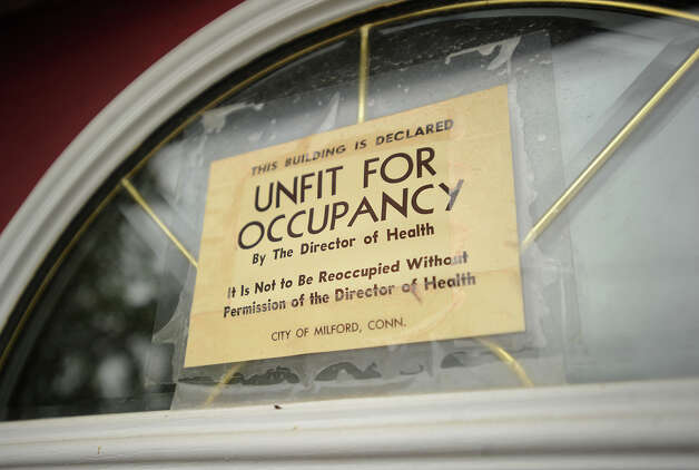 An unfit for occupancy sign above the front door of a Sandy damaged home on James Street in Milford, Conn. on Wednesday, October 23, 2013. Photo: Brian A. Pounds / Connecticut Post