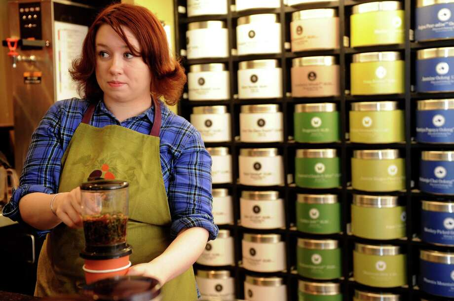 In this file photo, an employee makes tea at Teavana in the Trumbull Mall. Starbucks, which bought the tea chain last November for $600 million, plans to open its first tea bar in New York City. Photo: Lindsay Niegelberg, ST / Connecticut Post