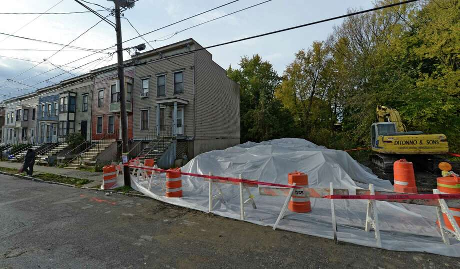 Red tape is drawn around the remains of 232 1st Street Wednesday morning Oct. 23, 2013, warning of asbestos contamination which was found during the demolition of the house after a late afternoon fire destroyed the dwelling in Albany, N.Y.         (Skip Dickstein / Times Union) Photo: Skip Dickstein