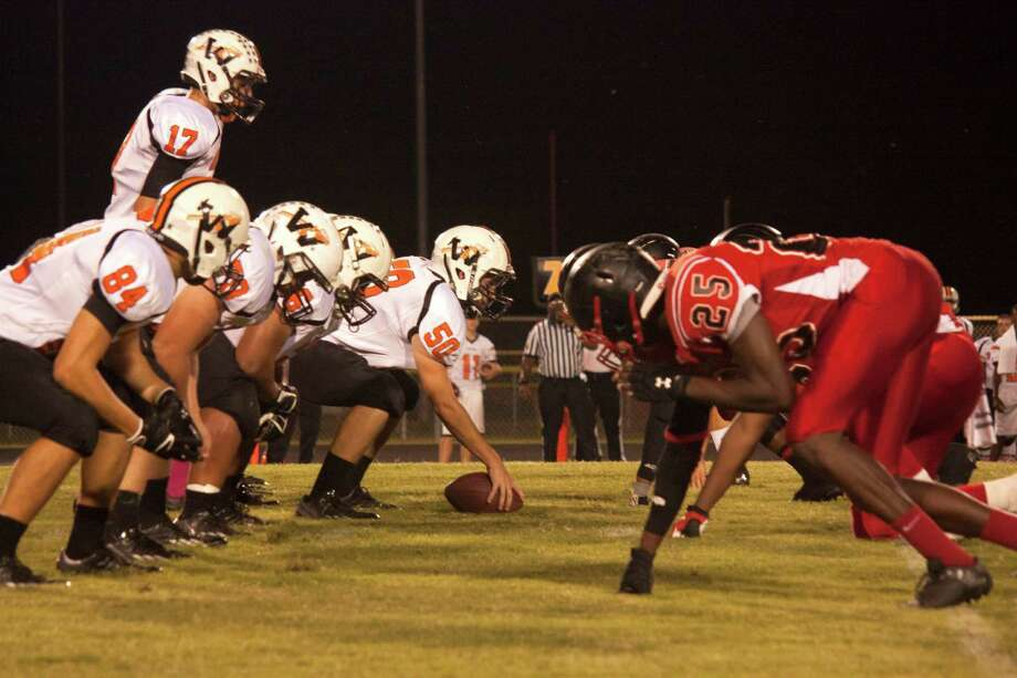 The Warren offense lines up against Koutnze's defense in a game earlier this season. Despite starting off district play with four losses, including a 52-0 loss to Kountze, Warren remains confident they can turn things around. Tim Monzingo/The Enterprise Photo: Tim Monzingo