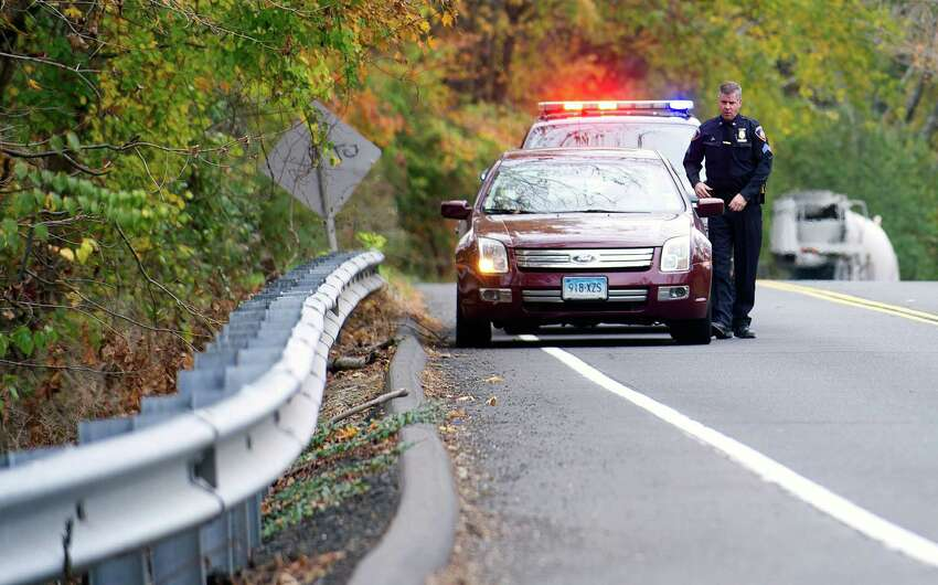 FILE -Stamford police Sgt. Andrew Gallagher stops a driver for speeding on High Ridge Road on Wednesday, October 23, 2013.