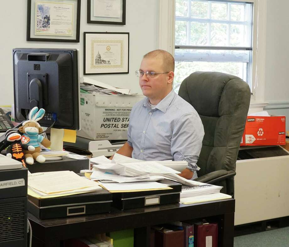 Denocrat Registrar of Voters Matthew Waggner was back in the office Tuesday, following an incident where his GOP counterpart, Roger Autuori, slapped him in the face. Photo: Genevieve Reilly / Fairfield Citizen